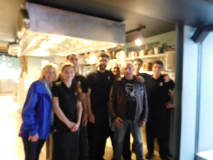 A drunk chef from Paris took this wonderful photo of us with the chef and crew. We thought it was in focus at the time :).